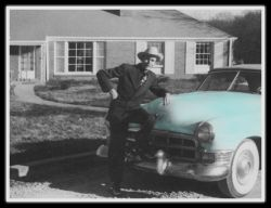 Hank  Williams in front of his new house in Nashville with the  Cadillac